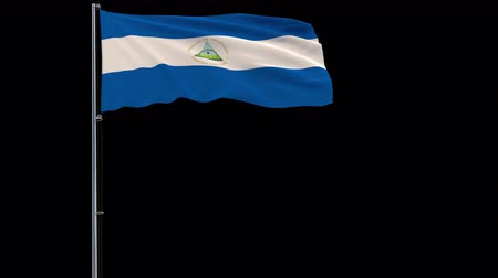 nicaraguan : Isolate big flag of Nicaragua on a flagpole fluttering in the wind on a transparent background, 3d rendering, 4k prores 4444 footage with alpha transparency