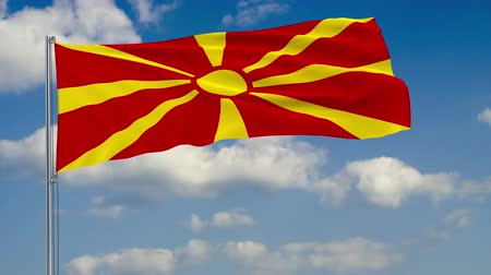 macedonian : Flag of Macedonia against background of clouds floating on the blue sky Stock Footage