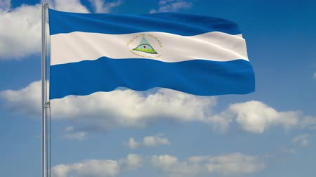 nicaraguan : Flag of Nicaragua against background of clouds floating on the blue sky Stock Footage