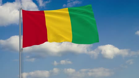 깃대 : Flag of Guinea against background of clouds floating on the blue sky 무비클립