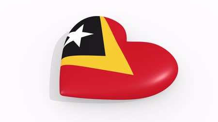 seks : Heart in colors and symbols of East Timor on white background, loop