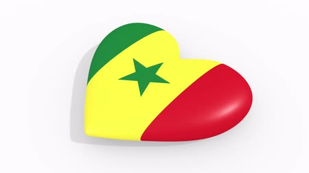 nationality : Heart in colors and symbols of Senegal on white background, loop