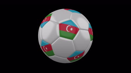 baku : Soccer ball with the flag of Azerbaijan colors rotates on transparent background.