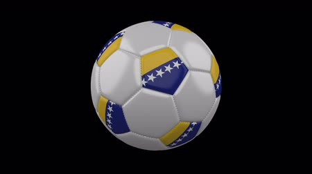 herzegovina : Soccer ball with the flag of Bosnia and Herzegovina colors rotates on transparent background. Stock Footage