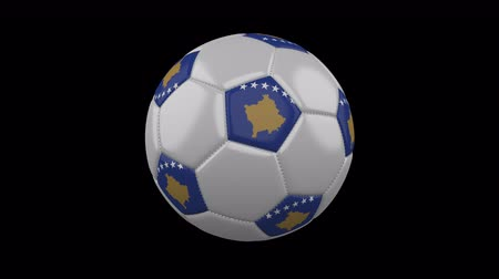 sérvia : Soccer ball with the flag of Kosovo colors rotates on transparent background, 3d rendering, prores footage with alpha channel, loop Vídeos