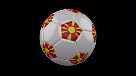 macedonian : Soccer ball with the flag of Macedonia colors rotates on transparent background, prores footage with alpha channel, 3d rendering, loop