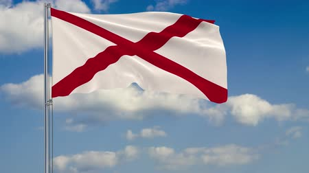 alabama : Flag of Alabama - US state fluttering in the wind against a cloudy sky Stock Footage
