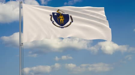 Бостон : Flag of Massachusetts - US state fluttering in the wind against a cloudy sky Стоковые видеозаписи
