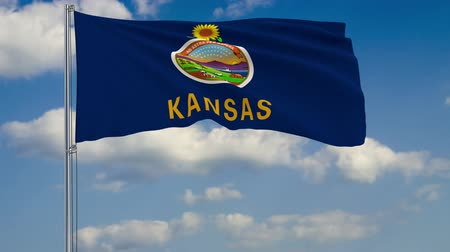 birlik : Flag of Kansas - US state fluttering in the wind against a cloudy sky