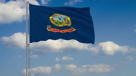 idaho : Flag of Idaho - US state fluttering in the wind against a cloudy sky