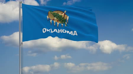 címer : Flag of Oklahoma - US state fluttering in the wind against a cloudy sky