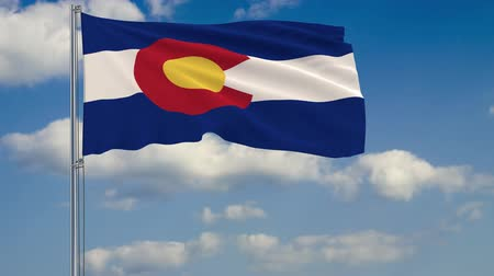 birlik : Flag of Colorado - US state fluttering in the wind against a cloudy sky