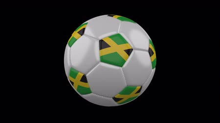 jamajka : Soccer ball with flag Jamaica colors rotates on transparent background, 3d rendering, 4k prores footage with alpha channel, loop Wideo