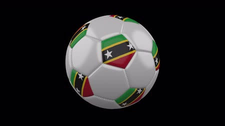 cuciture : Soccer ball with flag Saint Kitts and Nevis colors rotates on transparent background, 3d rendering, 4k prores footage with alpha channel, loop Filmati Stock
