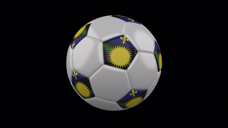 cuciture : Soccer ball with flag Guadeloupe colors rotates on transparent background, 3d rendering, 4k prores footage with alpha channel, loop