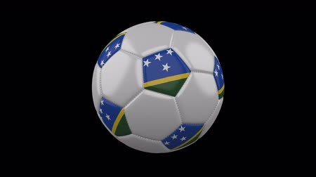 melanesia : Soccer ball with flag Solomon Islands colors rotates on transparent background, 3d rendering, 4k prores footage with alpha channel, loop Stock Footage