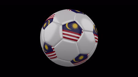 kalimantan : Soccer ball with flag Malaysia colors rotates on transparent background, 3d rendering, loop, 4k prores footage with alpha channel Stock Footage