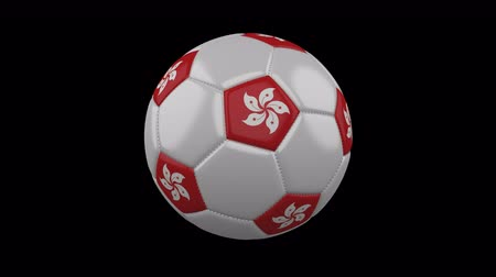 pentágono : Soccer ball with flag Hong Kong colors rotates on transparent background, 3d rendering, loop, 4k prores footage with alpha channel