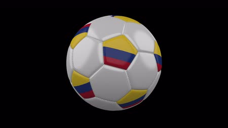 bogota : Soccer ball with the flag of Colombia colors rotates on transparent background, 3d rendering, loop, 4k prores footage with alpha channel