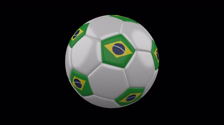 brazil : Soccer ball with the flag of Brazil colors rotates on transparent background, 3d rendering, loop, 4k prores footage with alpha channel