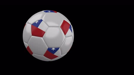 kreskówki : Soccer ball with the flag of Chile flies past the camera, slow motion, 4k footage with alpha channel Wideo