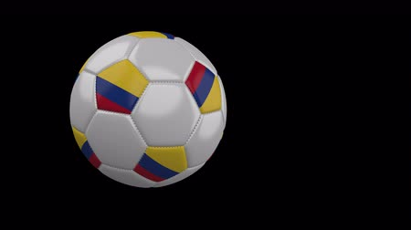 bogota : Soccer ball with the flag of Colombia flies past the camera, slow motion, 4k footage with alpha channel Stock Footage