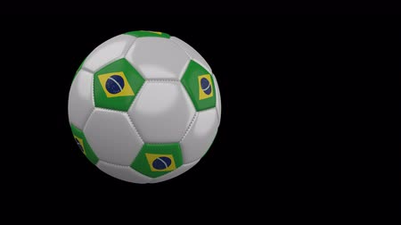 tek bir nesne : Soccer ball with the flag of Brazil flies past the camera, slow motion, 4k footage with alpha channel