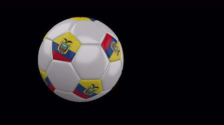 quito : Soccer ball with the flag of Ecuador flies past the camera, slow motion, 4k footage with alpha channel
