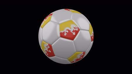 bhutan : Soccer ball with the flag of Bhutan colors rotates on transparent background, 3d rendering, prores footage with alpha channel, loop