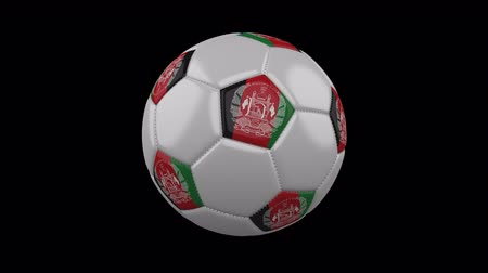 afghan : Soccer ball with the flag of Afghanistan colors rotates on transparent background, 3d rendering, prores footage with alpha channel, loop