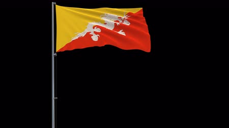 oficial : Isolate big flag of Bhutan on a flagpole fluttering in the wind on a transparent background, 3d rendering, 4k prores 4444 footage with alpha transparency
