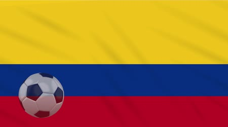 bogota : Flag of Colombia and soccer ball rotates against background of waving cloth