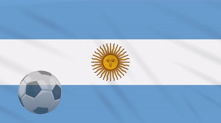 aires : Flag of Argentina and soccer ball rotates against background of waving cloth Stock Footage