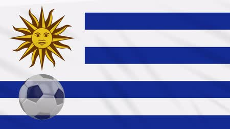 montevideo : Flag of Uruguay and soccer ball rotates against background of waving cloth Stock Footage