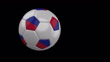 príncipe : Soccer ball with the flag of Haiti flies past the camera, slow motion, 4k footage with alpha channel