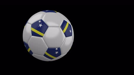curacao : Soccer ball with the flag of Curacao flies past the camera, slow motion, 4k footage with alpha channel