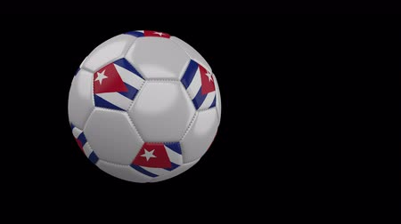 múlt : Soccer ball with the flag of Cuba flies past the camera, slow motion, 4k footage with alpha channel Stock mozgókép