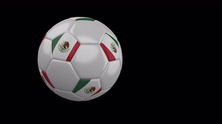 mexico city : Soccer ball with the flag of Mexico flies past the camera, slow motion, 4k footage with alpha channel