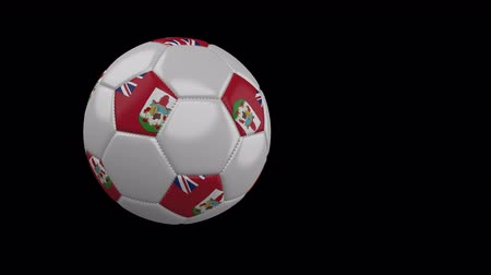 bermudas : Soccer ball with the flag of Bermuda flies past the camera, slow motion, 4k footage with alpha channel