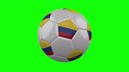 bogota : Soccer ball with Colombia flag rotates on green chroma key background, loop
