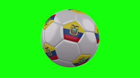 quito : Soccer ball with Ecuador flag rotates on green chroma key background, loop