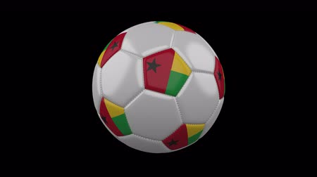 gine : Soccer ball with flag Guinea Bissau, 3d rendering, rotation loop Stok Video