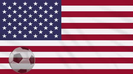 決勝 : USA flag and soccer ball rotates against background of a waving cloth, loop 動画素材