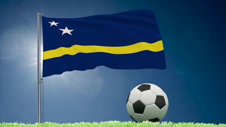curacao : Flag of Curacao fluttering and a fsoccer ball rolls on the lawn, 3d rendering