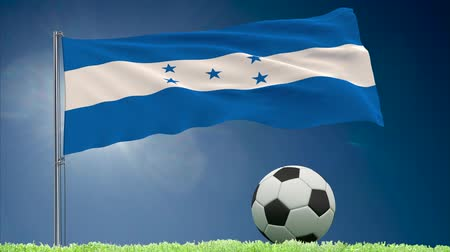 bulutsuz : Flag of Honduras fluttering and a fsoccer ball rolls on the lawn, 3d rendering