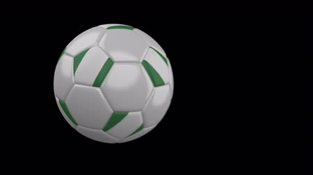 múlt : Soccer ball with flag Nigeria flies past camera, slow motion blur, 4k footage with alpha channel