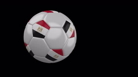 カイロ : Soccer ball with flag Egypt flies past camera, slow motion blur, 4k footage with alpha channel