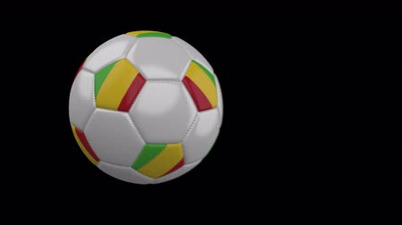 múlt : Soccer ball with flag Mali flies past camera, slow motion blur, 4k footage with alpha channel Stock mozgókép