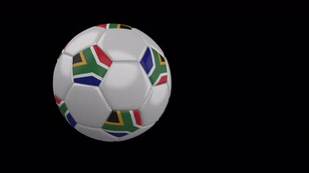 pretoria : Soccer ball with flag South Africa flies past camera, slow motion blur, 4k footage with alpha channel Stock Footage