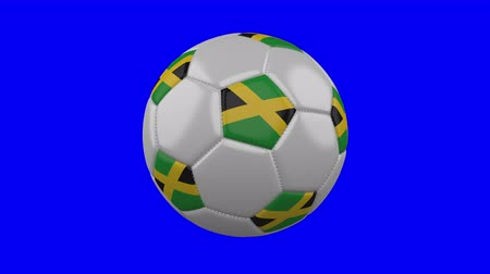 jamaica : Soccer ball with Jamaica flag rotates on blue chroma key background, loop Stock Footage